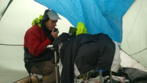 M0WUT operating under a tarpaulin in the leaking tent